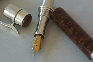Partially assembled; nib section and cap finial